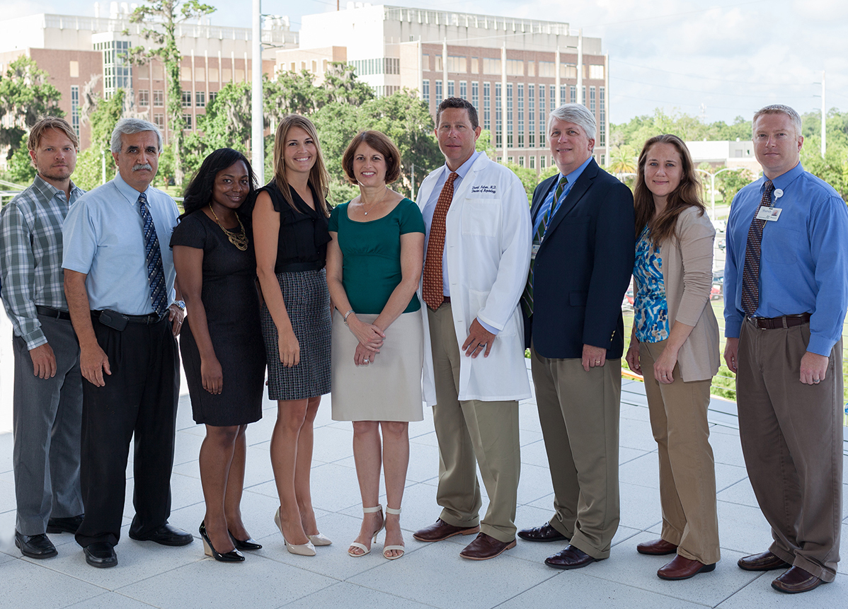 Left to right: Michael Bertulfo, former program assistant; Ben Burkley, Center for Pharmacogenomics; Taimour Langaee, Center for Pharmacogenomics; Aniwaa Owusu Obeng, PGY2 pharmacogenomic resident; Amanda Elsey, program manager; Julie A. Johnson, program director; David R. Nelson, CTSI director; David Nessl, UF PathLabs; Kim Newsom, UF PathLabs; Ben Staley, Shands Pharmacy (photo by Jesse Jones)